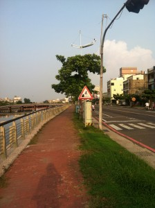 A street near the canal in Tainan. Full size and check out that sign.