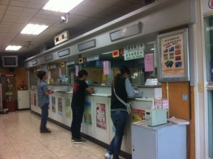 This half of the Cheng Da postal office is devoted to banking services. Like any bank in Taiwan, the first step is to take a number, as distributed by the machine in the foreground.